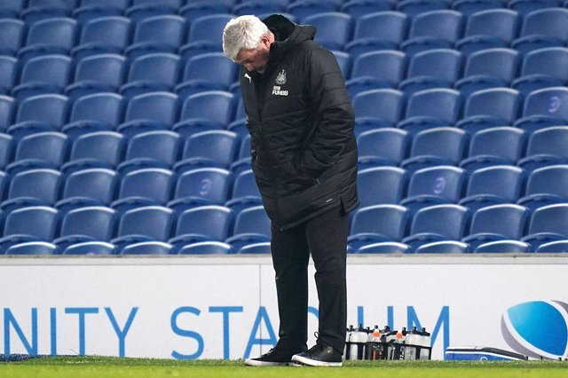 Newcastle United's English head coach Steve Bruce looks on during the English Premier League football match between Brighton and Hove Albion and Newcastle United at the American Express Community Stadium in Brighton, southern England on March 20, 2021.