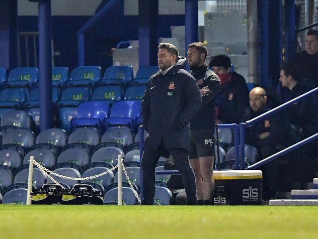 Lee Johnson watches his side produce a superb performance at Fratton Park