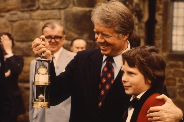 President Jimmy Carter with the miners lamp presented to him by Ian McAree, the youngest member of Washington Welfare Band in May 1977.