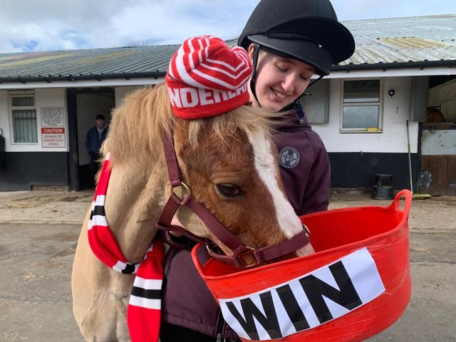 Yellow, pictured with yard staff member Georgia Shaw, has predicted a Sunderland victory in Sunday's Papa John's Trophy final.