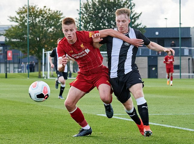 Niall Brookwell takes on Newcastle's Tom Midgely during an U18 Premier League game. Brookwell has joined Newcastle from Liverpool.