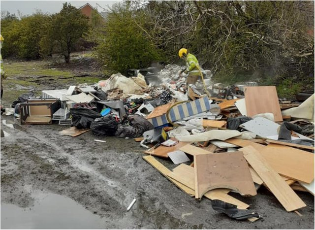 Crews dampened a huge pile of fly-tipped rubbish in Shotton Colliery.