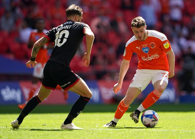 Blackpool's Elliot Embleton (right) and Lincoln City's Jorge Grant battle for the ball during the Sky Bet League One playoff final match held at Wembley Stadium, London. Picture date: Sunday May 30, 2021.