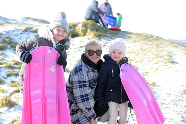 Sledging on Cleadon Hills. Kayleigh Scott with daughters Tilly, ten and Elle, three.