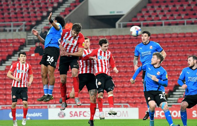 Charlie Wyke heads Sunderland into the lead at the Stadium of Light