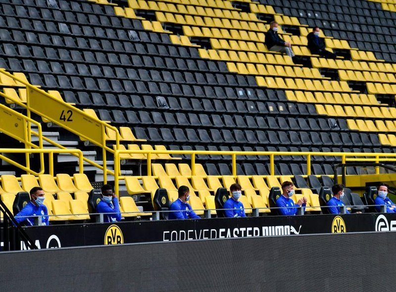 Players on the bench were told to socially distance, and were sat two metres apart during the game.