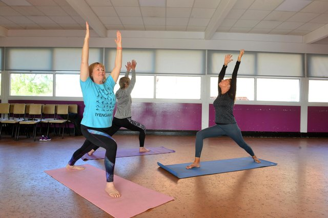 Julie Cook, right and her yoga class are keen to start again after months away. Picture bu Stu Norton.