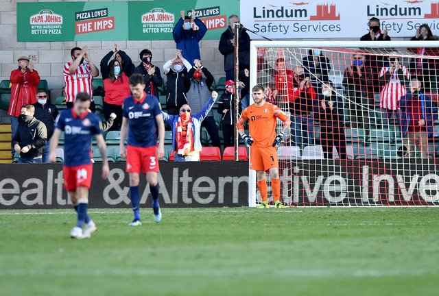 Sunderland goalkeeper Lee Burge looks on after conceding Lincoln City's second goal