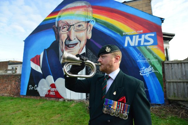 Bugler Scot Barrs plays the Last Post at the unveiling of the Sir Tom Moore mural Picture by FRANK REID