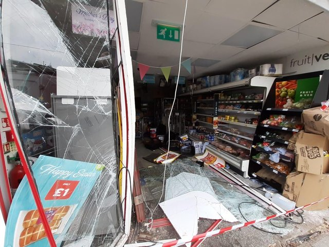 Inside the shop following the damage.