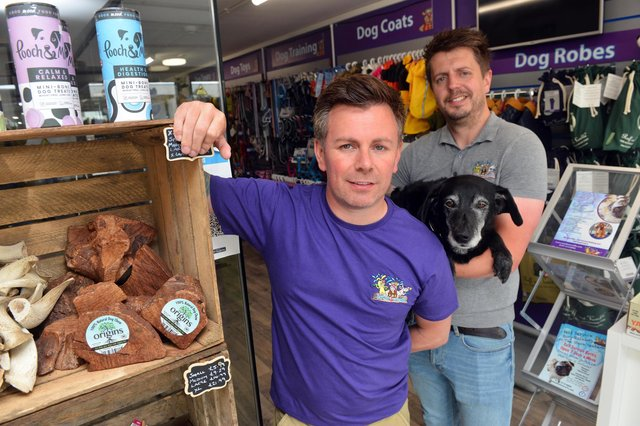 Woofs N Scruffs owners Mark (left) and David Potts-Brown with dog Halle.
