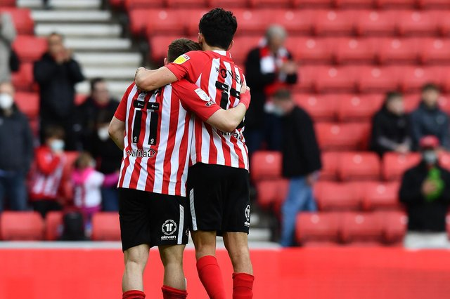 Lynden Gooch and Luke O'Nien at the end of the game.