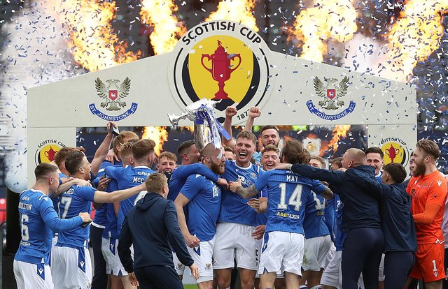 GLASGOW, SCOTLAND - MAY 22: St Johnstone captain Jason Kerr lifts the trophy following the Scottish Cup Final between Hibernian and St Johnstone at Hampden Park on May 22, 2021 in Glasgow, Scotland. A limited number of fans will be allowed into the stadium as Coronavirus restrictions begin to ease in the UK. (Photo by Ian MacNicol/Getty Images)