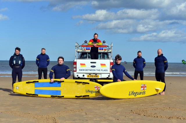 RNLI lifeguards training ready for the summer season with a stay safe summer of staycation message.
