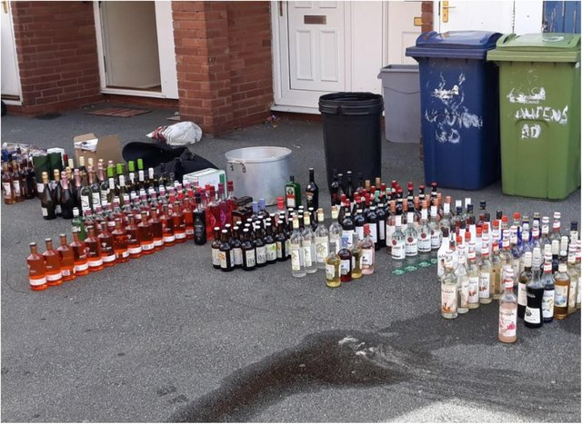 A total of £5,000 worth of alcohol was found in the wheelie bin.