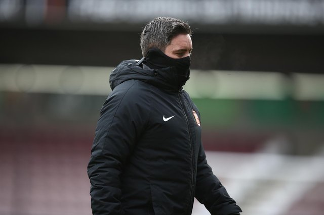 Sunderland manager Lee Johnson walks from the pitch prior to the Sky Bet League One match between Northampton Town and Sunderland at PTS Academy Stadium on January 2, 2021.