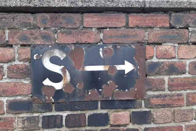 The sign used to point to an air raid shelter during World War II.