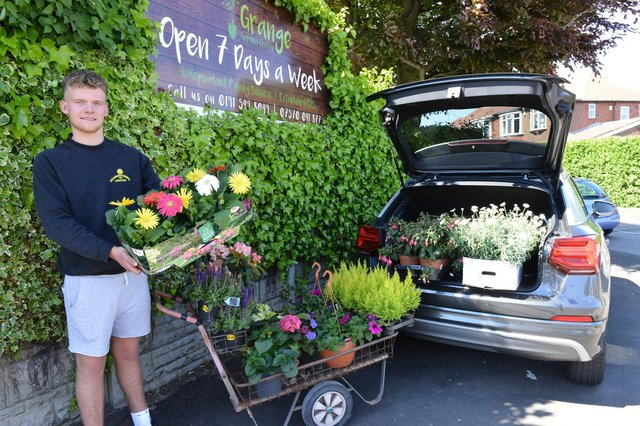 Christian Carney owner of the Grange Garden Centre loading his car to make a delivery. Picture by FRANK REID