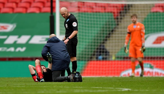 Tom Flanagan needed treatment just before half-time.