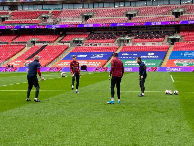 The Sunderland players warm up at Wembley.