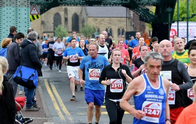 Runners head over the Wearmouth Bridge following a previous Sunderland City Runs festival