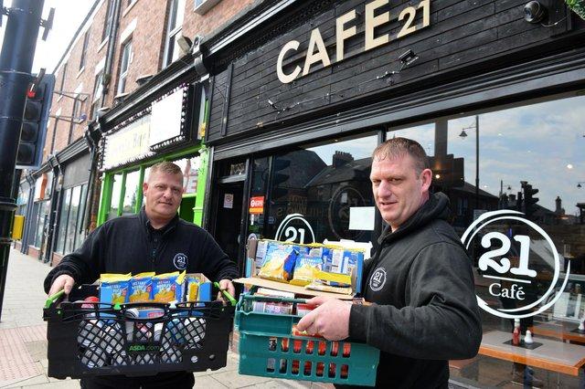 Cafe 21 owners Stan Johnson (left) and Dave Potter who are offering free food to those in need.