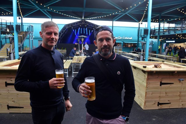 Steven Thompson, left, and Michael raise a glass at the seaside venue's first night of business.