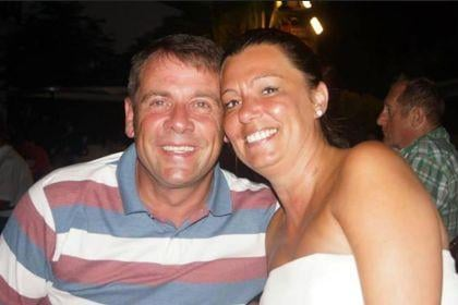 Andrea Oliver pictured with her husband Marc - she has urged men to support the women in their lives by ensuring they go for their smear test.