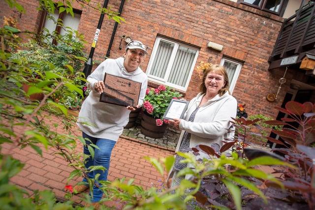 Last year's Gentoo community garden winners at Ayton Gardens with their award.