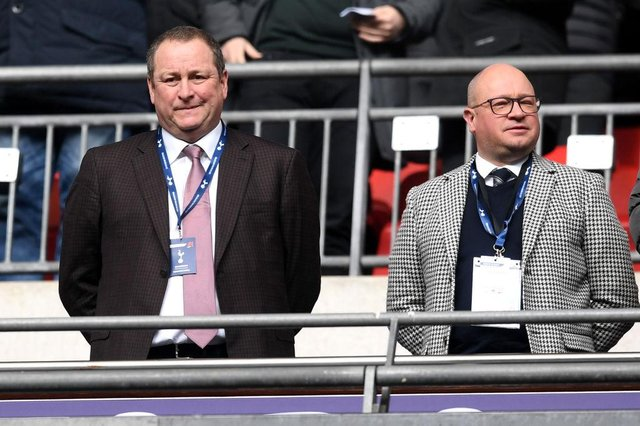 Mike Ashley, Newcastle United owner and Lee Charnley look on prior to the Premier League match between Tottenham Hotspur and Newcastle United at Wembley Stadium on February 2, 2019 in London, United Kingdom.