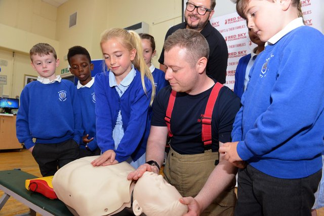 Firefighter Chris Smith and Red Sky Foundation founder Sergio Petrucci visited St Mary's RC Primary School to show pupils how to do CPR and how a defibrillator works.