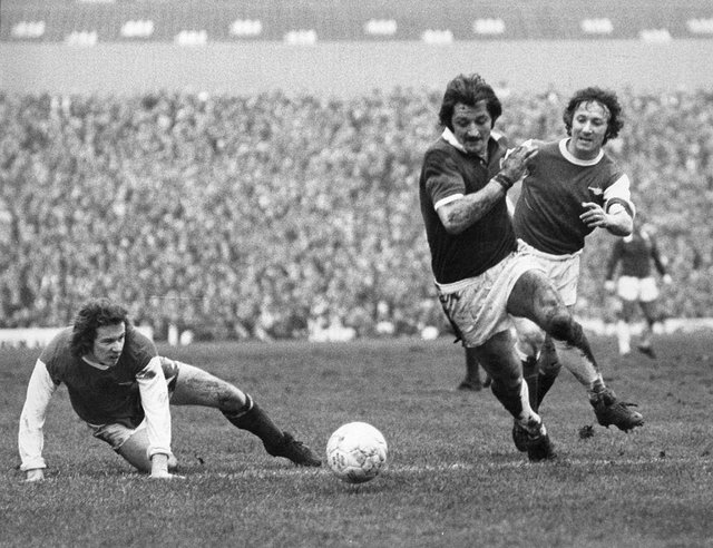 Arsenal's Liam Brady watches, unable to reach the ball, as team mate George Armstrong  (1944 - 2000) races after Leicester City's Frank Worthington, during their FA Cup fifth round tie at Highbury.  (Photo by Central Press/Getty Images)