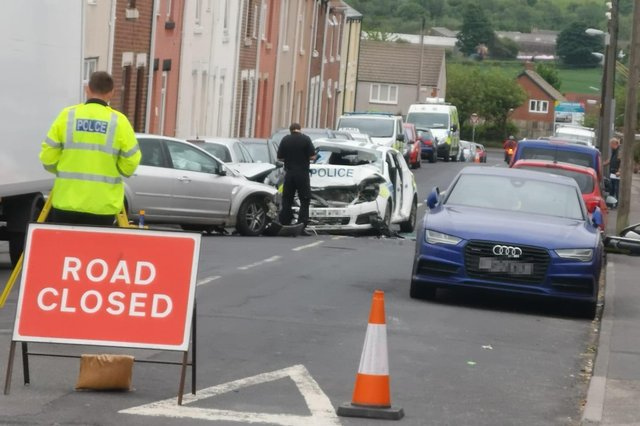 The scene following the crash, in which two officers were taken to hospital. Photo: John Ball.