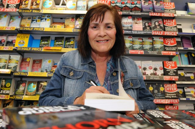 Author Sheila Quigley signs copies of her latest book in WH Smith's in 2011.