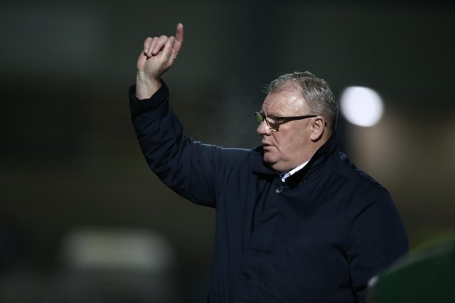 Gillingham manager Steve Evans gives instructions during the Sky Bet League One match between Northampton Town and Gillingham at PTS Academy Stadium.