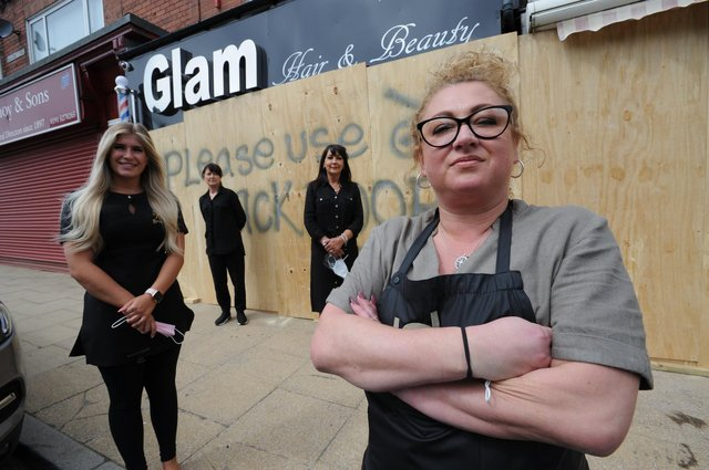 Glam Hair Salon owner Lisa Turner, with staff Brogan Milson, Catherine Bullock, and Maria Arnell outside the boarded up business in Seaside Lane, Easington Colliery.