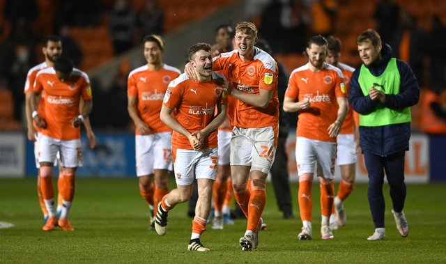 BLACKPOOL, ENGLAND - MAY 21: Blackpool players Elliot Embleton (l) and Daniel Ballard celebrate after the Sky Bet League One Play-off Semi Final 2nd Leg match between Blackpool and Oxford United at Bloomfield Road on May 21, 2021 in Blackpool, England. A limited number of fans will be allowed into the stadium as Coronavirus restrictions begin to ease in the UK following the COVID-19 pandemic. (Photo by Gareth Copley/Getty Images)