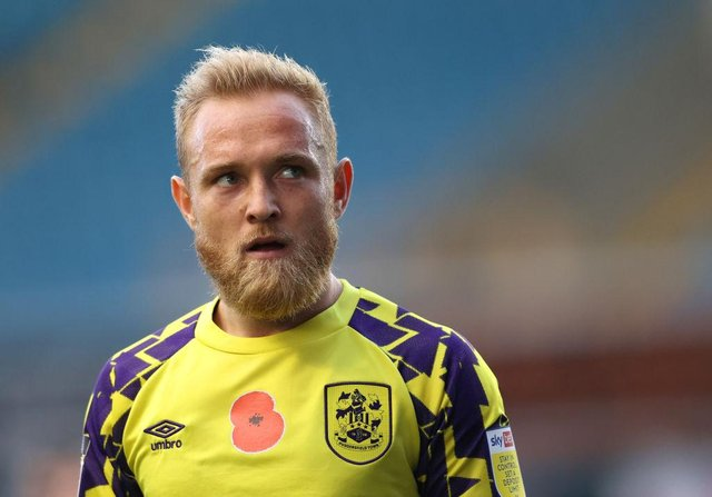 Alex Pritchard playing for Huddersfield Town.