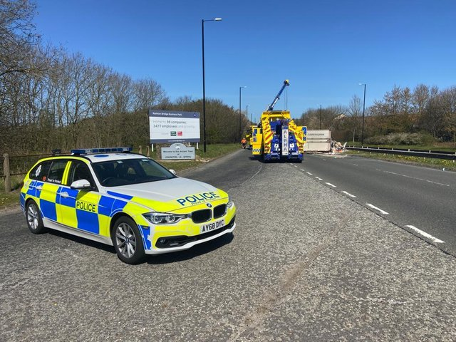 Police on the scene of the collision on the A690.