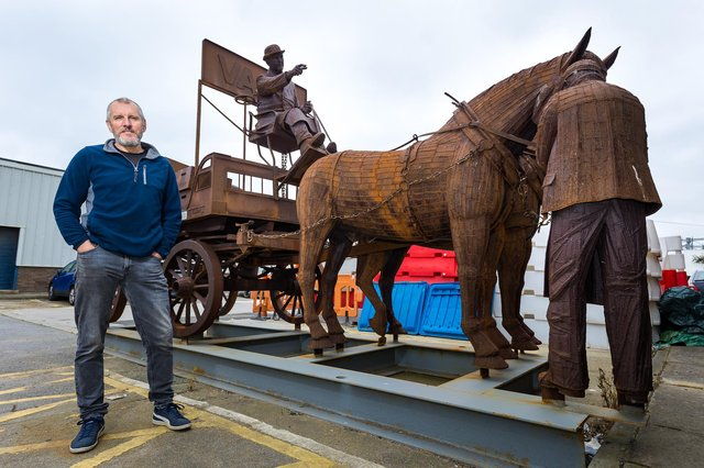 Artist Ray Lonsdale with his metal sculpture 'Gan Canny'.