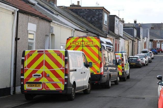 """Police in Lumley Street as inquiries began into the then """"unexplained"""" death."""