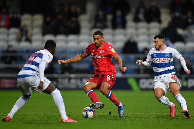 Sam Baldock of Reading takes on Ilias Chair of Queens Park Rangers and Bright Osayi-Samuel of Queens Park Rangers.