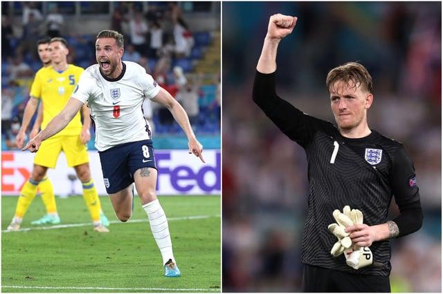 Jordan Henderson (left) celebrates his first ever England goal while Jordan Pickford salutes the fans