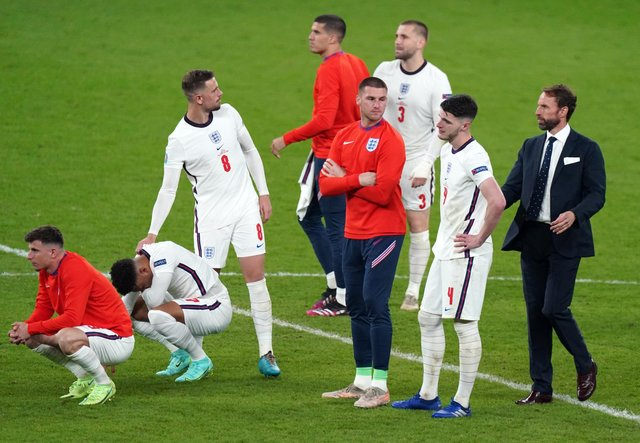 England manager Gareth Southgate (right) is dejected with is players following the penalty shoot out during the UEFA Euro 2020 Final at Wembley Stadium, London. Picture date: Sunday July 11, 2021.