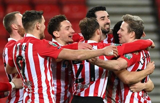 Sunderland players congratulate Grant Leadbitter of Sunderland after he scores the winning penalty during the Papa John's Trophy semi-final match between Sunderland and Lincoln City on February 17, 2021.