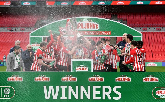 Sunderland players celebrate with the Papa John's Trophy after the Papa John's Trophy Final match between Sunderland and Tranmere Rovers on March 14, 2021.