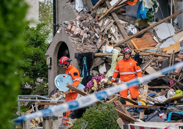 Emergency workers at the scene of a suspected gas explosion, in which a young child was killed and two people were seriously injured, on Mallowdale Ave Heysham which caused 2 houses to collapse and badly damaged another. Picture date: Sunday May 16, 2021.