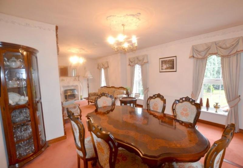 The dining room is large and full of character. The quirky room has space and lots of room for dining guests. There are double glazed windows and the open plan room leads to the lounge.