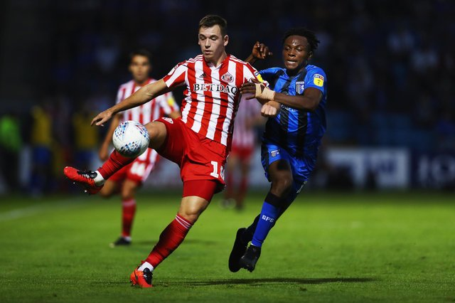 GILLINGHAM, UNITED KINGDOM - AUGUST 22:  Donald Love of Sunderland battles for posession with Regan Charles-Cook of Gillingham during the Sky Bet League One match between Gillingham and Sunderland at Priestfield Stadium on August 22, 2018 in Gillingham, United Kingdom.  (Photo by Naomi Baker/Getty Images)