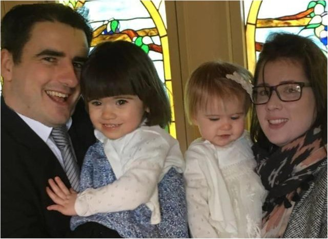 Sarah with her husband James and two young children Amelia and Isabella.